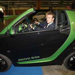 Mondial de l'Automobile 2014. Porte de Versailles <br /> Visit of Emmanuel Macron, Minister of Economy, Industry and digital to promote electric cars<br /> France Paris 10/04/2014